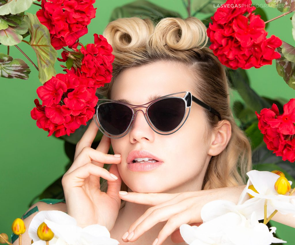 model-with-flowers-and-sunglasses-pose
